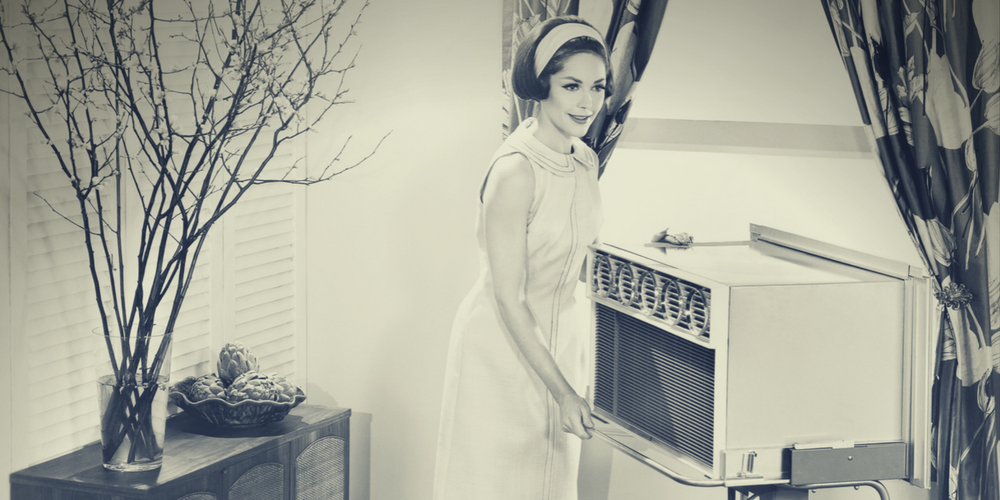 50s woman in front of a/c - air conditioning installation